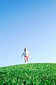 Girl running on hill