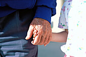 Grandfather holding hands with granddaughter