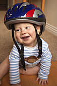 baby with bike helmet