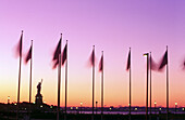 Statue of Liberty with flags. NYC, USA