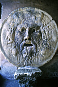 Bas-relief known as Mouth of Truth according to an old legend, in the porch of Santa Maria in Cosmedin church. Rome. Italy