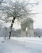 Snow-covered Washington Arch in Washington Square Park, Manhattan, NYC. USA