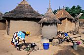 Mande woman cooking at Sibi village. Mali