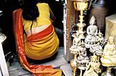 Woman with sari in a copper gifts shop. Kathmandu. Nepal