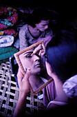 Hijrah making up before performance in circus. Punjab province, Pakistan