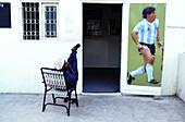 Poster of Maradona on the entrance door of Shiddi soccer club. Lyari district, Karachi. Sindh province, Pakistan