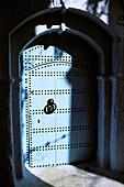 Typical indigo door in Chechaouene. Rif region, Morocco