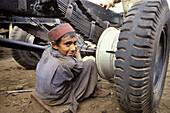 Garage mechanic. Young boy at work. Peshawar. NWFP (North-West Frontier Province (northwest Pakistan). Pakistan.