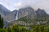 Clouds over Yosemite Falls and granite rock cliffs above Yosemite Valley, Yosemite National Park, Callifornia