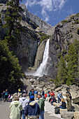 Tourists watch waterfall water, Lower Yosemite Fall, Yosemite Valley, Yosemite National Park, California