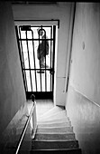 Adult, Adults, B&W, Black-and-White, Closed, Contemporary, Daytime, Door, Doors, Exit, Exits, Full-body, Full-length, House, Houses, Housing, Human, Indoor, Indoors, Inside, Interior, Male, Man, Mature Adult, Mature Adults, Mature people, Men, Men only,
