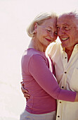 Couple, Couples, Daytime, Embrace, Embracing, Exterior, Female, Fondness, Gray-haired, Grey-haired