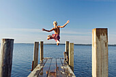 Action, Activity, Amusement, Back view, Bathing suit, Bathing suits, Blond, Blonds, Boy, Boys, Caucasian, Caucasians, Child, Children, Color, Colour, Contemporary, Daytime, Determination, Dive, Diving, Dock, Docks, Exterior, Fair-haired, Free, Freedom, F