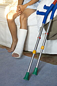 Anonymous, At home, Barefeet, Barefoot, Boy, Boys, Carpet, Carpets, Child, Children, Color, Colour, Contemporary, Crutch, Crutches, Daytime, Floor, Floors, Fracture, Fractures, Health, Home, Human, Indoor, Indoors, Inside, Interior, Kid, Kids, Leg, Legs,