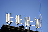 Antenna, Antennae, Antennas, Blue, Blue sky, Cell phone, Cell phones, Cellular phone, Cellular phones, Cities, City, Color, Colour, Communication, Communications, Concept, Concepts, Daytime, Detail, Details, Exterior, Horizontal, Industrial, Industry, Mo