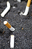 Addiction, Addictions, Butt, Butts, Cigarette, Cigarettes, Close up, Close-up, Closeup, Color, Colour, Concept, Concepts, Contemporary, Detail, Details, Indoor, Indoors, Inside, Interior, Still life, Stub, Stubs, Tobacco, Tobacco abuse, Vertical, F58-253