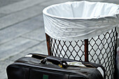Baskets, Briefcase, Briefcases, Broken, Color, Colour, Concept, Concepts, Daytime, Detail, Details, Exterior, Horizontal, Object, Objects, Outdoor, Outdoors, Outside, Shattered, Street, Streets, Thing, Things, Trash bin, Trash bins, Urban, Wastebasket, W