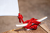Color, Colour, Concept, Concepts, Cord, Cords, Daytime, Detail, Details, Exterior, Horizontal, Outdoor, Outdoors, Outside, Red, Safety, Security, String, Strings, Tied, F58-293435, agefotostock