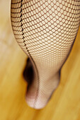 Accessories, Accessory, Adult, Adults, Black, Color, Colour, Contemporary, Detail, Details, Female, Feminine, Garment, Human, Indoor, Indoors, Interior, Leg, Legs, Net stockings, One, One person, People, Person, Persons, Provocative, Selective focus, Sex