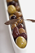 Aliment, Aliments, Appetizer, Appetizers, Bowl, Bowls, Color, Colour, Food, Foodstuff, Health, Healthy, Healthy food, Mediterranean, Olive, Olives, Selective focus, Snack, Snacks, Still life, White, F58-526299, agefotostock