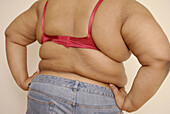 Adult, Adults, Back view, Body, Body part, Body parts, Bra, Bras, Brassiere, Color, Colour, Contemporary, Detail, Details, Fat, Female, Figure, Flabbiness, Flaccidity, Fold, Folds, Health, Human, Indoor, Indoors, Interior, One, One person, Overweight, Pe