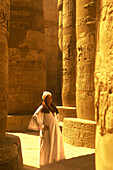 Guide, Hypostyle hall great temple of amun karnak, Luxor ruins, Egypt.