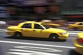 Street scene, Taxi cabs, Times square, Manhattan, New York, USA.
