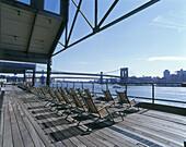 Pier 17, South Street seaport, East River bridges, Manhattan, New York, USA.