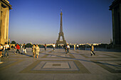 Cities, City, Cityscape, Cityscapes, Color, Colour, Daytime, Eiffel Tower, Engineering, Europe, Exterior, France, Human, Monument, Monuments, Motion, Movement, Moving, Outdoor, Outdoors, Outside, Paris, People, Person, Persons, Symbol, Symbols, Tower, To