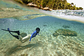 Split image of free diver next to sandy bottom and island huts, Verde Island, Philippines