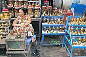 Snake vendor at market. Vinh Long. Vietnam