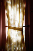 At home, Color, Colour, Concept, Concepts, Curtain, Curtains, Daytime, Decoration, Detail, Details, Fabric, Half-light, Home, Indoor, Indoors, Inside, Interior, Protect, Protection, Silence, Sunlight, Vertical, Window, Windows, F76-232612, agefotostock