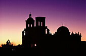 Mission San Xavier del Bac (aka White Dove of the Desert). Tohono O odham indian reservation at dusk. Tucson. USA