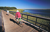 Couple riding bicycles. Eastham. Cape Cod. MA. USA