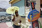 Black female, sample drink. Dutch. Philipsburg. Great Bay. Sint Maarten.