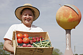 Headley s Fresh Fruits and Vegetable s, local produce, roadside, peach water tower. Clanton. Chilton County. Alabama. USA.