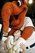 Riverwalk Stadium, Biscuit Baseball, AA Minor League, fan, boy, mascot, Big Mo. Montgomery. Alabama. USA.