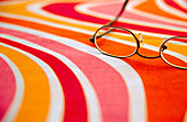 Close up, Close-up, Color, Colour, Concept, Concepts, Eyeglasses, Glasses, Horizontal, Indoor, Indoors, Inside, Interior, Lens, Lenses, Object, Objects, One, One item, Optics, Shape, Shapes, Spectacles, Still life, Still lifes, Still lives, Surface, Surf