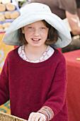 Young girl at farmer s market in Santa Fe, New Mexico