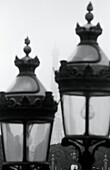 B&W, Black-and-White, Cities, City, Close up, Close-up, Concept, Concepts, Daytime, Detail, Details, Europe, Exterior, France, Monochromatic, Monochrome, Outdoor, Outdoors, Outside, Pair, Paris, Street lamp, Street lamps, Turned off, Two, Urban, Vertical