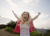 Happy girl screams out her joy, Los Angeles, CA, USA