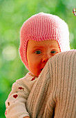 1 to 6 months, 1-6 months, Adult, Adults, Affection, Babies, Baby, Blue eyed, Blue eyes, Blue-eyed, Bonding, Caucasian, Child, Children, Close up, Close-up, Color, Colour, Contemporary, Exterior, Face, Faces, Families, Family, Female, Fondness, Hat, Hats
