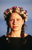 Girl with a wreath made of flowers on Midsummer s Eve. Västerbotten, Sweden