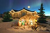 Outdoor Christmas Nativity scene with Northern lights overhead. Alberta, Canada