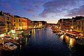Canale Grande with illuminated houses and restasurants at dusk, Venice, Venezia, Italy