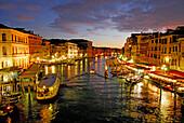 Canal Grande with illuminated houses and restasurants at dusk, Venice, Venezia, Italy