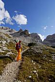 Young woman ascending Forcella di Lech, Alta Via delle Dolomiti No. 1, Parco Naturale Fanes-Sennes, Dolomites, South Tyrol, Alta Badia, Italy