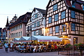 Cafe in the old town of Colmar in the evening light, Alsace, France