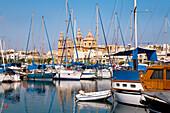 Sailing boats at the marina in front of St. Joseph Church, Msida, Malta, Europe