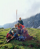 Family on a summit, Eng, Kleiner Ahornboden, Tyrol, Austria